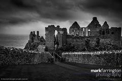 Dunluce Castle Ruins B&W (Mark R Farrington) Tags: uk sea blackandwhite bw castle monochrome rain architecture contrast canon photography eos coast ruins europe unitedkingdom britain cliffs 7d northernireland ulster countyantrim dunluce dunlucecastle desc2012