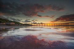 Reflecting on a Summer Sunset (steveniceton.co.uk) Tags: saltburn saltburnbythesea saltburnnorthyorkshire northeastengland northyorkshire north northsea teesside pier seascape landscape landscapes reflections tramonto sunset