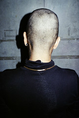 Dolly After Her Shave (Graham Meyer) Tags: film 35mm women bald konica bkk shaven hexaraf portraitfrombehind