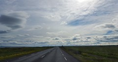 Somewhere in Iceland. (Harish Kumar N) Tags: road trip morning blue sky sun sunlight white green nature beauty car clouds circle photography drive iceland europe alone driving afternoon cross jeep natural outdoor arctic volcanoes vast criss expanse reyjkavik