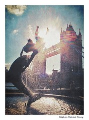 Girl with Dolphin (Steve Denny) Tags: sunset sky sunlight london water fountain clouds towerbridge statues sunrays riverthames lomogram canonpowershotg10 stephenmichaeldenny microsoftnokia635