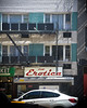 27th Street (281) West at 8th Avenue (shooting all the buildings in Manhattan) Tags: 27thstreet newyorkcity newyork 2015 architecture manhattan ny nyc september us signage elevation car