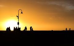 St Kilda breakwater (phunnyfotos) Tags: phunnyfotos australia victoria vic melbourne stkilda breakwater pier sunset sun sky summer weather silhouette people light lightpole evening nikon d750 nikond750 watchingthesunset portphillipbay coast coastal coastline shore windy