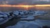 Sunset of a Cold Day (tinamar789) Tags: sea seashore ice icy rocks seascape sunset snow winter frost freezing cold lauttasaari helsinki finland