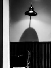 Absent:Soul [explored] (Bazzography!) Tags: emptychair empty lamp lampshade monochrome mono bazmatthews blackwhite blancoynegro noiretblanc bw cafe shadow curve emptiness nothing nothingness absence leica leicac explored explore inexplore