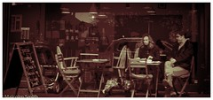 Cafe Life 3 (M C Smith) Tags: cafe people chairs tables window reflection board town