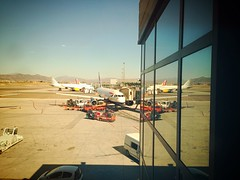 Home time (robjvale) Tags: vacation holiday hot reflection home window tarmac truck plane reflecting airport spain airline baggage britishairways runway malaga arid boarding