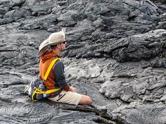a moment (warryronin) Tags: trip travel orange man black southamerica hat yellow stone island lava ecuador colorful break scenic tourist rest guide breeze galapagosislands goaheadtours