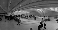 WTC PATH Entrance (Panorama) (Sebastian Sinisterra Photography) Tags: panorama bnw blackandwhite wide angle white marble wtc world trade center path port authority ny nj nyc newark new york jersey city downtown manhattan commuters mall transportation hub hoboken stiched leading lines afternoon clean pristine recent winter december silhouettes turnstiles train station corner around cool entrance indoor indoors lights phone photo