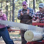 Students participate in the cross-cut sawing competition at Rolleo, an annual timbersports competition.