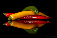Red (yellow and green) Hot Chilli Pepper (benno.dierauer) Tags: yellow rot red green grün gelb blackbackground schwarzerhintergrund peperoncini pepper tabletop 70d