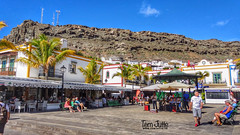 Plaza de la Musica Square, Puerto de Mogan, Gran Canaria, Spain - 4826 (HereIsTom) Tags: webshots travel europe netherlands holland dutch view nederland views you sony cybershot hx9v nature sun tourists cycle vakantie fietsvakantie cycling holiday bike bicycle fietsen la gran centre tourist colors sky ingles canaria musica charm playa town de reizen plein puerto mogán villaga del plaza square spain mogan fishing bergen clouds mountains