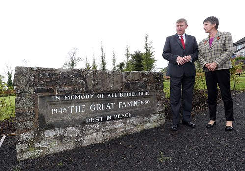 Social Development Minister Mervyn Storey, MLA views the Irvinestown Famine Graveyard with Chair of the Irvinestown Famine Graveyard Committee, Breege McCusker