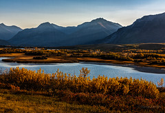 Maskinonge Lake, Waterton Lakes National Park (martincarlisle) Tags: autumn sunset canada mountains fall leaves rockies lakes parks alberta nationalparks bushes sunbeams canadianrockies watertonlakesnationalpark niksoftware tamronlenses canonxsi maskinongelake colourefex rocktymountains