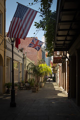 Abandoned alleyway (dharder9475) Tags: morning shadow sunlight alley neworleans americanflag flags walkway britishflag 2015 privpublic