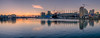 Just After Sunset (Sworldguy) Tags: vancouver falsecreek clouds water waterfront skyline architecture cityscape city shore evening night sunset nikon d7000 downtown dslr boats hdr highdynamicrange wideangle westcoast orange glowing reflections panorama pano britishcolumbia bcplace rodgersarena landscape