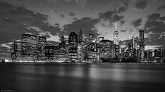 Manhattan night (New York) (Carlos Arriero) Tags: newyork estadosunidos nuevayork manhattan blackandwhite blancoynegro travel viajar américa eeuu nikon d800e nikkor 20mm nocturna panorama landscape paisaje skyline city cityscape ciudad carlosarriero cielo sky nubes clouds agua water río river eastriver desdebrooklyn night largaexposición longexposure citynight noiretblanc monochrome bw