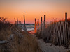 Buzzards Bay Sunset (Arno Gartzke) Tags: sky coast sand fence dune ocean surf cod cape capecod massachusetts bay buzzards red glow waves