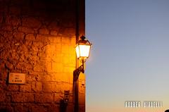The lamp on the wall (Instragram Andrea TigerVianelli) Tags: lamp lampione wall muro capture pitigiliano cityscape city borgo borghi medievale mura cielo sky italia italy toscana nikon d5100 andrea vianelli allaperto light minimalism