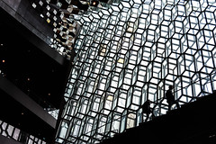 Ascent (trochford) Tags: windows light shadow people woman abstract man building glass architecture contrast canon climb iceland pattern geometry interior indoor monotone monochromatic reykjavik stairway backlit ascent harpa somecolor touchofcolor hintofcolor