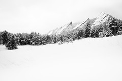 Flatirons in Winter (andrewgloor) Tags: park winter white foothills mountain snow black monochrome rock nikon colorado open space denver boulder climbing washout flatirons chautauqua d5100