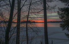 A Sunset at the Icebound Lake (Jyrki Liikanen) Tags: trees sunset lake silhouette landscape nikon december outdoor silhouettes crack icy icebound icecrack jyrkiliikanen