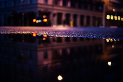cruisin' (ewitsoe) Tags: car street blur ewitsoe city impression poznan poalnd nikon reflection building europe cruise water puddle lights bokeh architecture december christmas dof 35mm