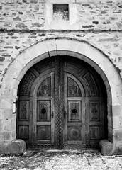 Voronet monastery entrance door (alxandru555) Tags: monastery manastire voronet bucovina ro romania suceava bw black white bnw monochrome fuji fujifilm xe2 door entrance architecture