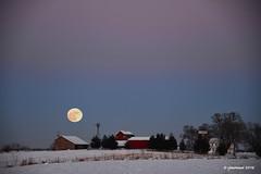 Farm Moon_163975 (rjmonner) Tags: windmill moon fullmoon iowa blue farm farmstead winter snow fence barn agriculture agronomic rural frozen fallow dormant moonrising dawn white