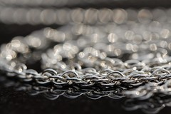 Made of Metal (haberlea) Tags: home macro macromondays metal chain silver hmm jewellery reflections light bokeh madeofmetal