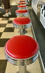 Have a Seat (Jellybeens Photography) Tags: checkeredfloor oldschool seating counter bar chrome humanleg indoors restaurant barstools red scenery person tower design