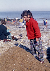 Kodacolor 1961 batch (theirhistory) Tags: colour film girl kid child snapshot negative trousers jumper 1960s sandcastle spade kodakcolor england1960s