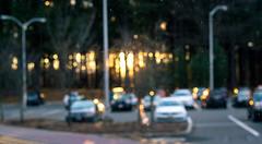 Watch the Glass (Richard Petrosino) Tags: hamden connecticut unitedstates sunset bokeh glass dirty dirt bright orange blue green grass trees woods forest lightrays golden cars parking bus quinnipiac