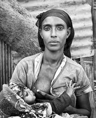 ethiopia - omo valley (mauriziopeddis) Tags: omo valley valle etiopia ethiopia bn bw bianconero blackandwhite reportage leica sl portrait ritratto allattamento child