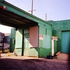 gas station (ADMurr) Tags: la eastside gas station fenced shuttered aqua teal green red signs rolleiflex zeiss planar 35 fuji chrome slide film 2014