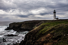 Watchful (Culinary Fool) Tags: lonely pacificocean yaquinahead 2016 2470mm28 clouds desolate oregon culinaryfool agatebeach alone newport sky lighthouse brendajpederson cliff april