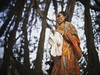 Elder hindu devotees pray 'Elder prayer' or 'buro buri puja' (auniket prantor) Tags: elder hindu prayer dhaka bangladesh women pigeon oblation pray goddess seek release from illness winter portrait editorial 2017 color photograph ritual worship
