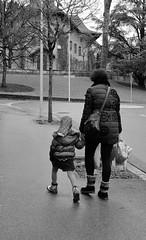 Striding up the hill (zinnia2012) Tags: street photography blackandwhite storytelling church pavement road mereetenfant zinnia2012 7dwf 23mmprimelens fujifilxt1 trees photosderue noiretblanc adventuresinseeing5 calltoadventure changeofsubject