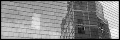 Distortion (Ramon Quaedvlieg Photo) Tags: distortion reflection glass building architecture architectural netherlands limburg zuidlimburg parkstad heerlen heerlencentrum heerlencity bongerd pancratiusplein pancratiussquare blackandwhite blackandwhitephotography city urban schunck