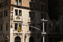 Sixth Avenue - New York City (USA) (Meteorry) Tags: nyc newyorkcity light usa newyork facade america hotel trafficlight shadows unitedstates manhattan unitedstatesofamerica midtown april empirestate oneway warwick bigapple 6thavenue 54thstreet avenueoftheamericas sixthavenue midtownmanhattan 2015 meteorry west54thstreet