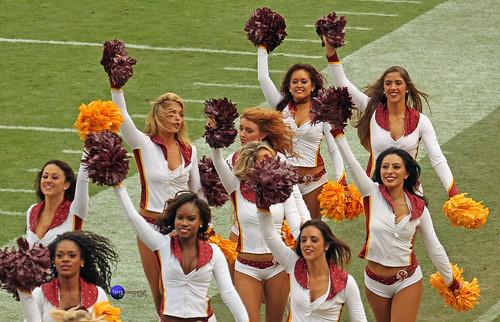 Redskinette Cheerleaders run off the field.