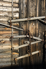 weathered legacy (Barbara A. White) Tags: vertical wooden chains rusted weathered farmimplements harnesses barnboard
