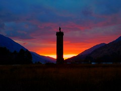 Glenfinnan Monument (David_Blair) Tags: scotland glenfinnan monument tower towers statue statues fields field grass mountain mountains landscape sun orange sky red sunset evening nikon nikoncoolpix nikoncoolpixl840 coolpix l840 redsky orangesky yellow yellowsky