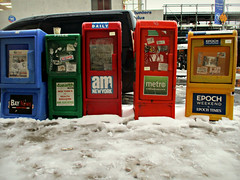 NY Free Newspapers (Huddled in the Cold n Snow) (Robert S. Photography) Tags: snow newspapers free stand street brooklyn newyork snowyday subway bus canon powershot elph160 iso250 december 2016