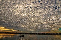 Under the heavy sky (bodro) Tags: kingharbor boat dramaticsky harbor haven heavyclouds lowclouds puffyclouds sunset