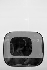 (cherco) Tags: train tren window ventana boy man composition composicion reflejos reflexions japan japon blackandwhite blancoynegro travel viaje urban ciudad city canon 60d