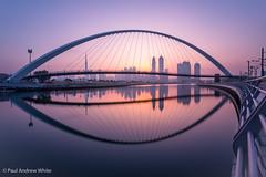 Dubai Mirror 1 (paul.andrew.white) Tags: dubai dubaiphotographer dubaicanal sunrise water canal cityscape skyline bridge