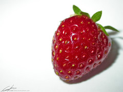 luscious strawberry (atomicshark) Tags: red food macro nature fruit yard garden dessert juicy yummy strawberry nikon colorful tasty fresh minimal sensual seeds delicious glossy eat coolpix gloss edible homegrown minimalist luscious coolpix4500 atomicshark
