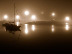 night fog (nj dodge) Tags: longexposure canada topf25 water fog sepia night boats lights harbor novascotia listeningto afterglow capesableisland dotallison northeastpoint utatasilhouette