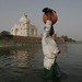 Man Carrying Pitcher Across Yamuna River Behind the Taj